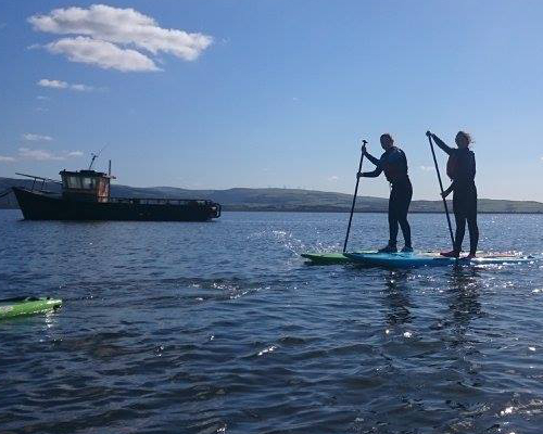 Stand up paddle boarding on the coastal Cardigan bay.