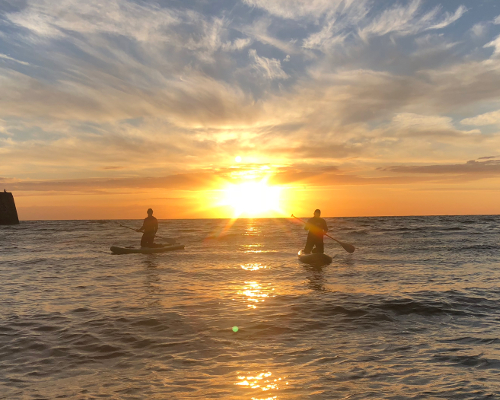 Sunset Paddle boarding at sea Cardigan bay